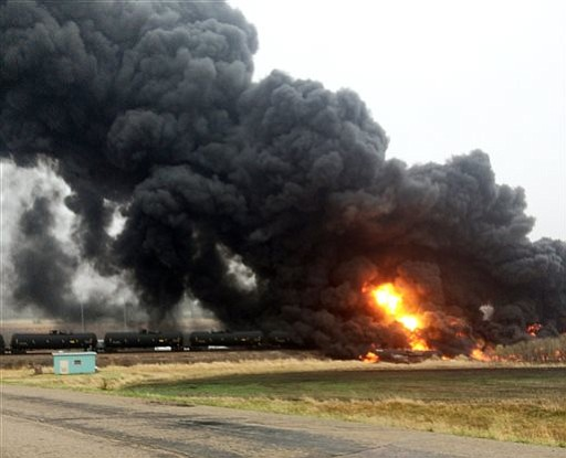 Smoke and fire rise from an oil train that derailed Wednesday, May 6 near Heimdal, N.D.