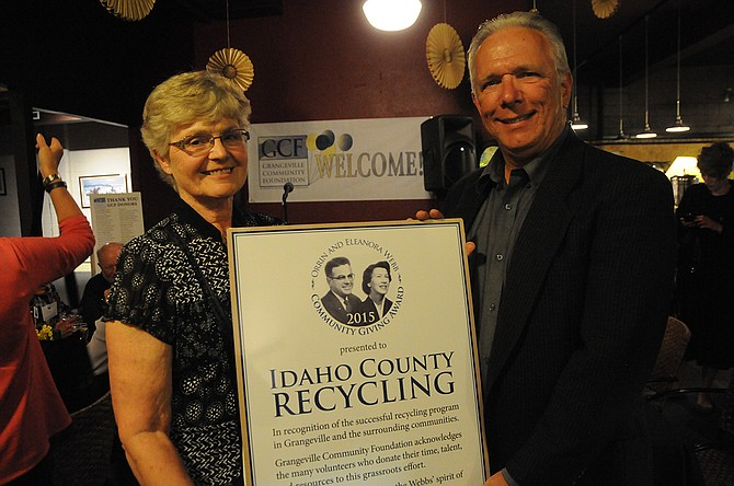 Idaho County Recycling volunteer Janie Fluharty accepts the 2015 Orrin and Eleanora Webb Community Giving Award on behalf of the organization from Grangeville Community Foundation President John Bennett. The award event was held at The Gallery in Grangeville May 7.