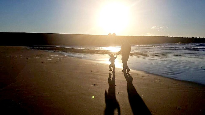 Jeff Hosman and a foster child walk along the beach in Oregon. Jeff and Becky Hosman of Grangeville have been serving as foster parents for the past year-plus.