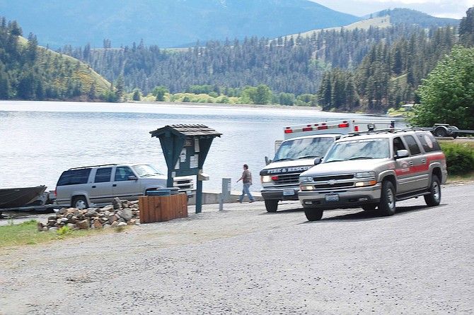 Two men are rescued from Conconully Lake after their boat turned over about 3:15 p.m. today.