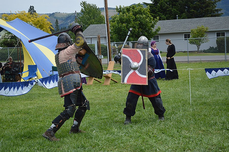 KNIGHTS battle with bamboo-like rattan swords at the Society for Creative Anachronism's medieval tournament, hosted last weekend at the Hood River County Fairgrounds.