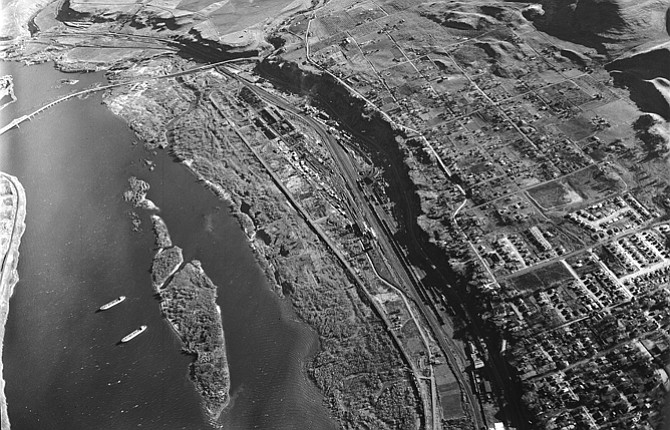"""The aerial photograph was taken Dec. 2, 1953, and is labled """"By-Pass Route."""" Interstate 84 and Highway 197 and The Dalles dam have yet to be built."""