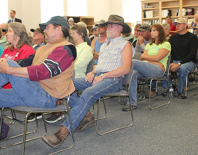 Approximately 50 residents turned out Wednesday afternoon to hear Okanogan County commissioners rule on a request to vacate Three Devils Road.