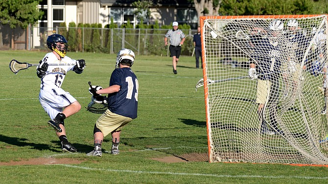 A STRONG PERFORMANCE: HRV's offense really took off in the the second half, spurred on by attack Levi Glass (top), who bends the mesh of Canby's net with a goal in the third quarter.
