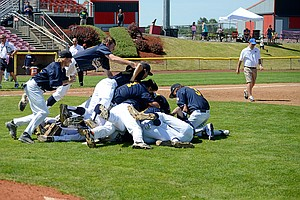 Players dive into the dogpile that formed at the end of the game.