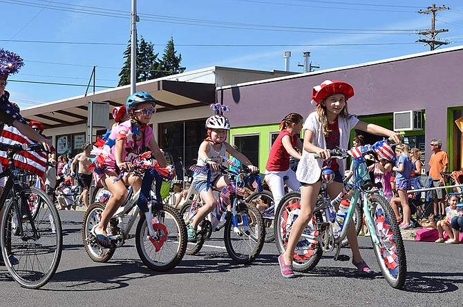 "CARE TO saddle up for the July 4 parades in Hood River County? Groups and individuals are welcome to get involved, just as these cyclists rode the route in 2014. This year's theme is ""Beautiful Bounty,"" and organizers are encouraging pre-registration for the parade (see story for details). Also on the schedule for July 4, the 4 p.m. Odell parade, which forms at 3 p.m. at Mid Valley Elementary."