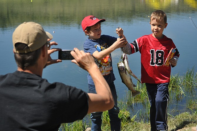 The 27th Annual Free Fishing Day event Saturday, June 13, at Wilkins Pond saw youngsters catch some trout with support from the Grangeville Lions Club, the Nez Perce-Clearwater National Forests, the Idaho Department of Fish and Game, and the Bureau of Land Management's Cottonwood office.