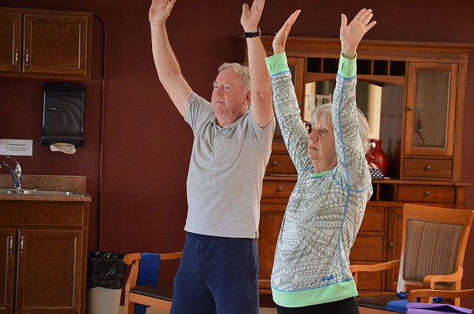 """, Dave Radley, left, and Doris Stevens are regulars in Shannon's class. """"I love the instructor,"""" said Stevens. """"You get a good workout and it relaxes you."""""""