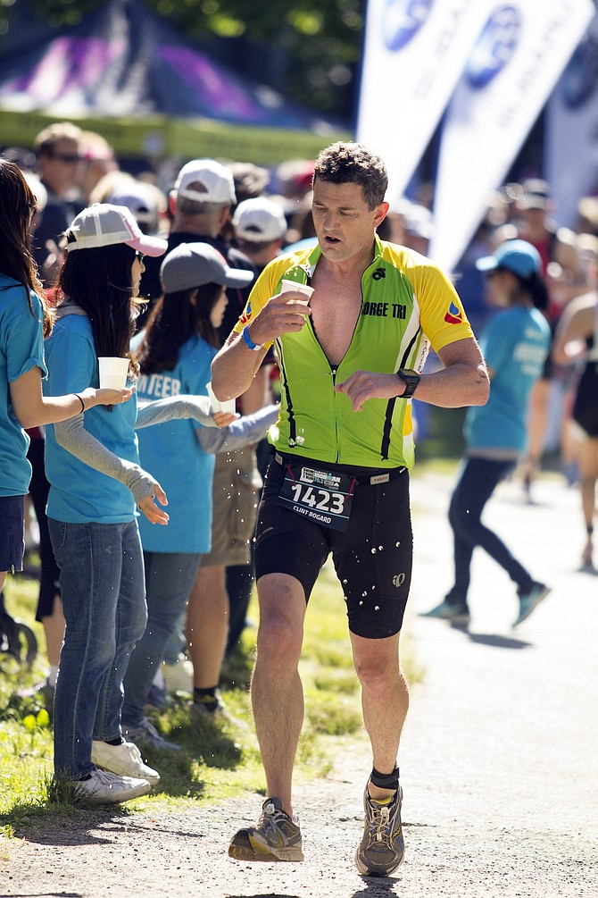 Clint Bogard grabs some refreshment during last week's Ironman 70.3 in Victoria, BC.