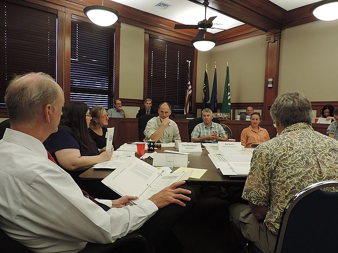 SEATING took an unusual shape Monday, for space reasons, as council and planning commission gathered round table-style and most staff sat in the council dais.