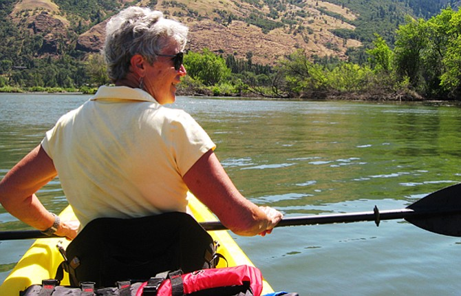 Janet Tschnanz explores the Columbia River on a sunny summer day. Temperatures are always lower on the water.