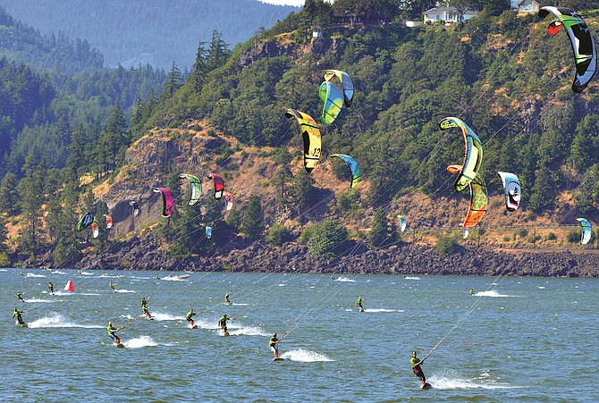 KITEBOARDERS cruise along the Columbia River during last year's Kiteboarding 4 Cancers event, which featured over 150 participants and raised over $150,000. The annual event returns next weekend, running from July 10-12.