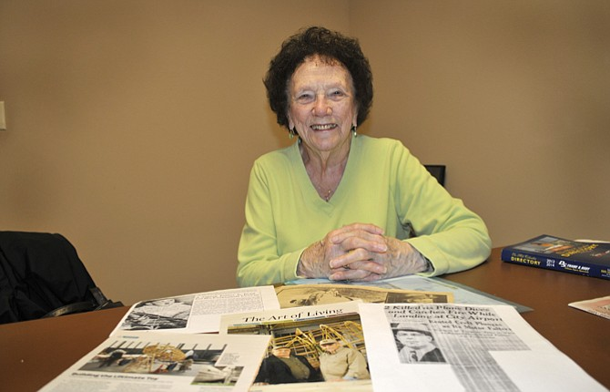"""Wynne Mae of The Dalles displays some of the many newspaper and magazine clippings she has gathered over the years relating to her namesake, Wiley Post's airplane, the """"Winnie Mae."""""""