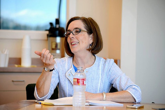 Governor Kate Brown talks with Hood River News editorial staff during a visit to Hood River, July 17, 2015. The visit was Brown's first to Hood River as Oregon governor.
