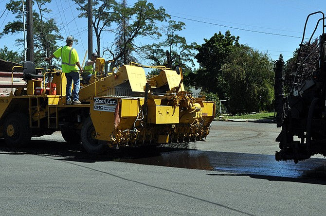 Crews with Herco of Lewiston lay down a layer of asphalt followed by a layer of rock chips along South Idaho Street on Thursday, July 30. Herco is conducting the $179,670 project on all paved streets in the southwest corner of town through Friday, July 31.