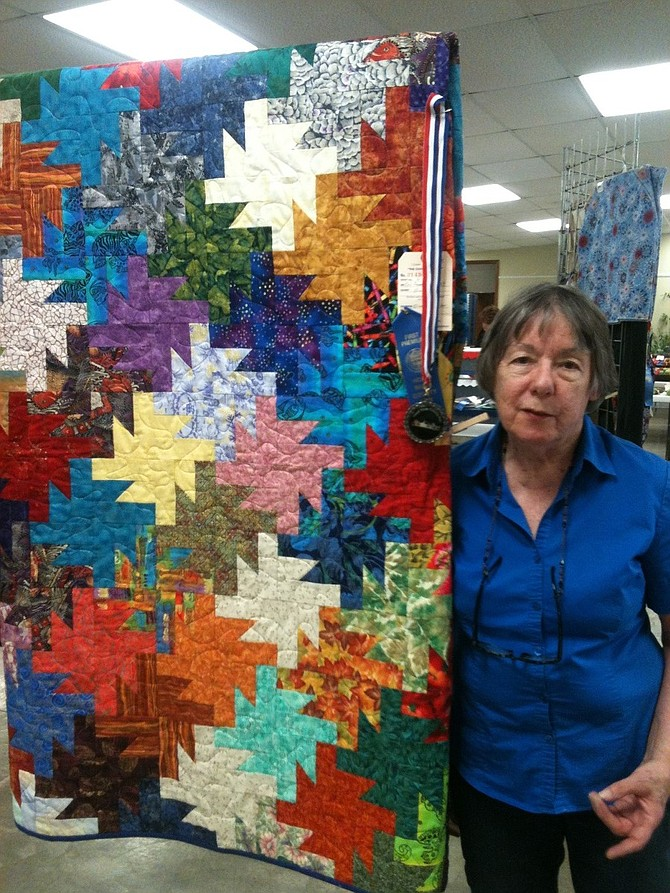 "TEXTILES: Elizabeth Garber with her ""tessellated star"" quilt, which won a blue ribbon; Elise Cain's felted raccoon and fox."