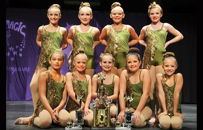 THE DALLES Dance team members participated in the Dance Magic Grand Championships ending on Aug. 4 at the Seaside Civic and Convention Center. In the picture are from left, back row, Maddie Malcolm, Ahnikah Rubio, Haley Peterson and Vivian Harrah. Front row are, from left, McKenna Strain, Tora Timinsky, Maddie Stembridge, Katelyn Vassar and Allie Masterson.