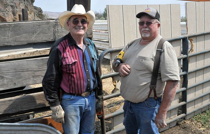 FORMER FORT Dalles Days Pro Rodeo president Wally Wolf, left, and current vice president Steve Hunt began taking apart the rodeo arena Sunday. Everything will be auctioned online at auctionsalesco.com on Sept. 9, 10 and 11.