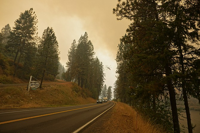 Helicopters continued to attack on the Lawyer Complex fires west of Kamiah on Wednesday afternoon, Aug. 12.