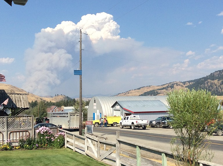 A plum of smoke rises above the community of Chesaw east of Oroville on Thursday afternoon.