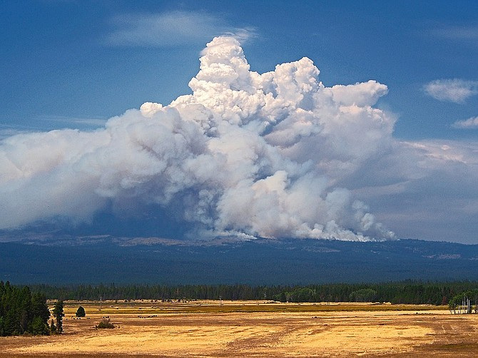 SMOKE billows from a wildfire on Mt. Adams which is now scorching 18,000 acres of forest land.