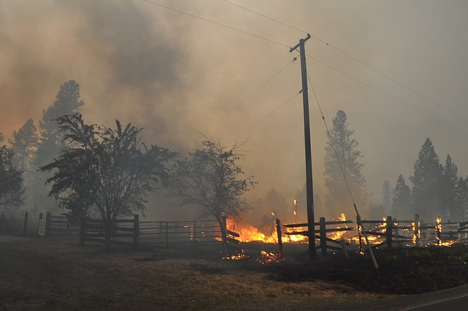 By 7 p.m. Friday evening in Kamiah, fire had driven many Woodland Road residents from their homes.