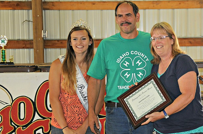 Distinguished 4-H Leaders   Joel and Nancy Costa of the Kooskia area were honored with the Idaho County Volunteer Leaders Distinguished Service Award 2015. This award recognizes an outstanding 4-H adult volunteer leader who has demonstrated leadership, initiative, dedication and commitment to the Idaho County 4-H Program. The Costas are leaders in the Tahoe Hillbillies 4-H Club. They are pictured here with 2015 Idaho County Fair Queen Brooke Eades.