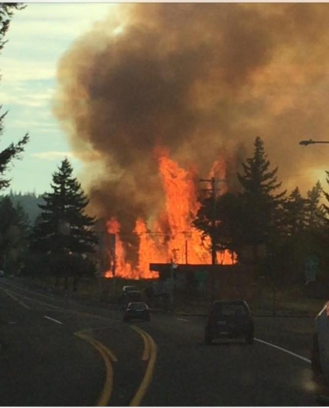 Fire burning along WaNaPa Street in Cascade Locks was knocked down Thursday night. Photo by Sara Reed.