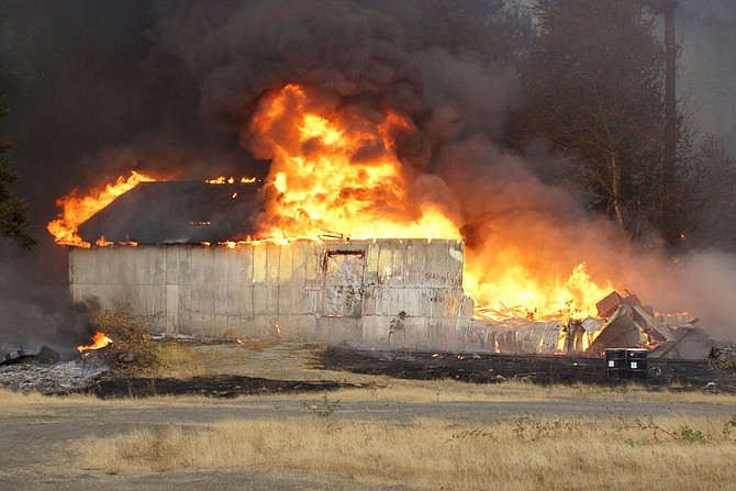 PORT of Cascade Locks storage shed goes up in flames shortly after 6 p.m. Thursday. Fire officials are still assessing the cause of the blaze, which broke out somewhere near the base of the hillside just south of the shed, along WaNaPa Avenue.