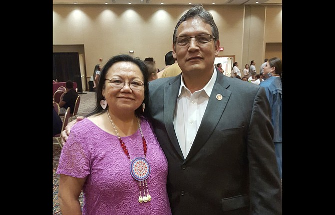 MARY SANDO-EMHOOLAH stands with Lee Adolf, national president of the Council for Tribal Employment Rights.	Contributed photo