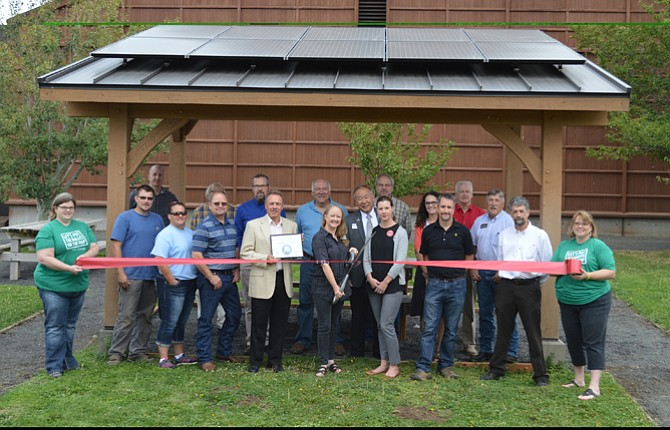 A new renewable energy exhibit was dedicated Aug. 28 at the Columbia Gorge Discovery Center, above.  Pictured left to right are, front row, Camille Terry, The Dalles Area Chamber of Commerce; Shamus Farrell, Mindy McHale, Dan McHale, Hire Electric; Dick Wanderscheid, Bonneville Environmental Foundation; Carolyn Purcell, Columbia Gorge Discovery Center; Darcy Nothnagle, Dave Karlson, Google; Dan Spatz, City of The Dalles, Columbia Gorge Discovery Center; Lisa Farqharson, The Dalles Area Chamber of Commerce. Back row, Daniel Hunter, City of The Dalles; John Langfeldt, Columbia Gorge Discovery Center; Jonathan Lewis, Hire Electric; Tom Lieurance, Frank Toda, Columbia Gorge Community College; Scott Hege, Wasco County Commissioners; Andrea Klaas, Port of The Dalles; Dave Griffith, Griffith Motors; Rod Runyon, Wasco County Commissioner. 	Photo courtesy Tiffany Hardin