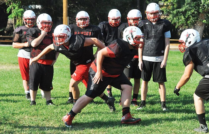 MEMBERS OF THE Dufur offensive line take part in drills last week at Dufur City Park. The Rangers have depth and size on the line, as it tries to build on a 10-win season in 2014 with another Big Sky Conference league title and a state championship for head coach Jack Henderson.