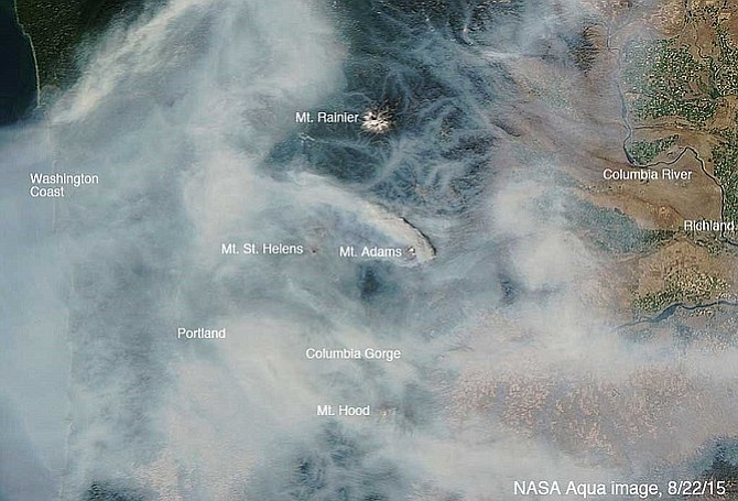 In this image taken by NASA's Aqua satellite last Saturday, fire smoke blankets the Northwest.