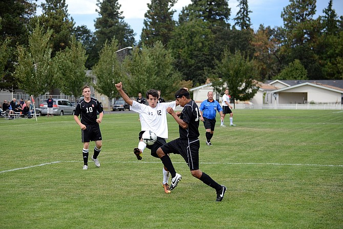 HORIZON CHRISTIAN'S co-ed soccer team saw its first game of the season last week: a 1-0 loss to Santiam Christian. Above, junior middie Quinn Roetcisoender kicks the ball away from a Santiam defender.