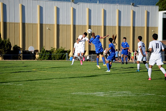 HRV BOYS SOCCER had its home opener against Hillsboro on Tuesday, which ended in a 1-1 draw. Senior forward Andres Baeza (in white) contests for a header with a Hillsboro player.