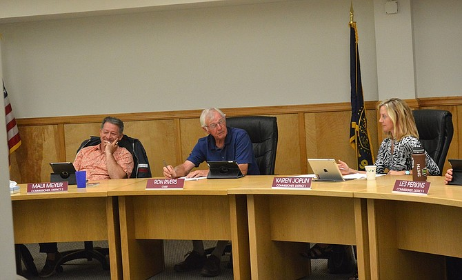 Commissioners decided Monday night to enter a property purchase agreement with SDS Lumber of Bingen to buy nearly 3,000 acres of forest land in Hood River County.