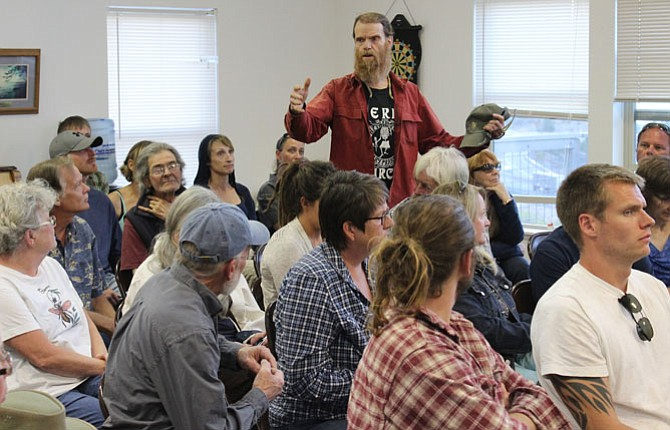 Longtime Wasco County resident Chuck Barker, standing, was one of many citizens who asked the board of commissioners not to opt out of marijuana businesses Monday night at a packed town hall in the Mosier Senior Center.