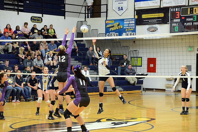 BIANCA BADILLO (No. 4) sends one into Hermiston territory during Tuesday's game in Hood River. Badillo, a junior, had a great game with six kills, four assists, and three service aces in HRV's win.