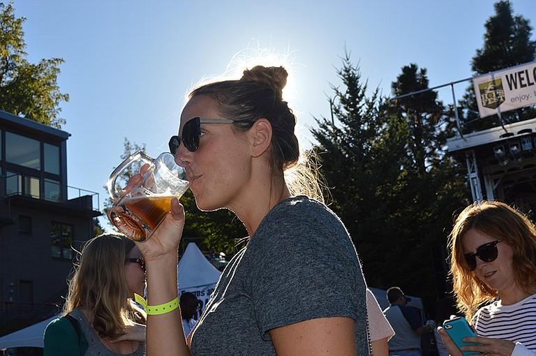 Hops Fest glass mug shines in the setting sun