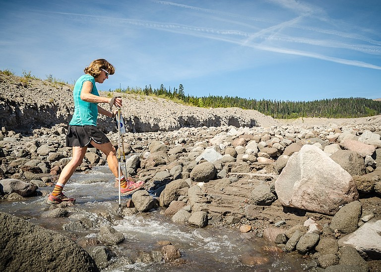 Lynne Davidson crosses a creek to refill her water bottle, somewhere in the Oregon Cascades.
