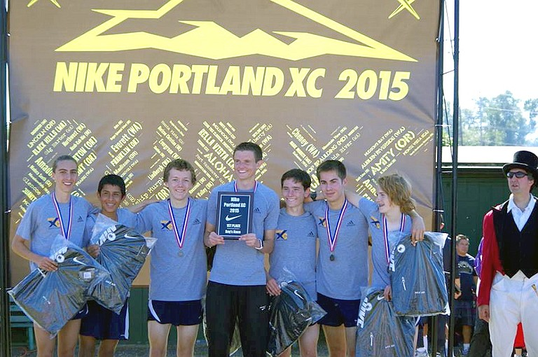 HRV HARRIERS were busy this weekend setting personal records (or getting close to them) at the Nike Portland XC meet on Saturday. Above, the boys celebrate their medals and swag after their first-place victory.