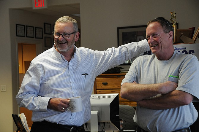 Andy McNab has a laugh with friend, Lowell Williams, Sept. 25.