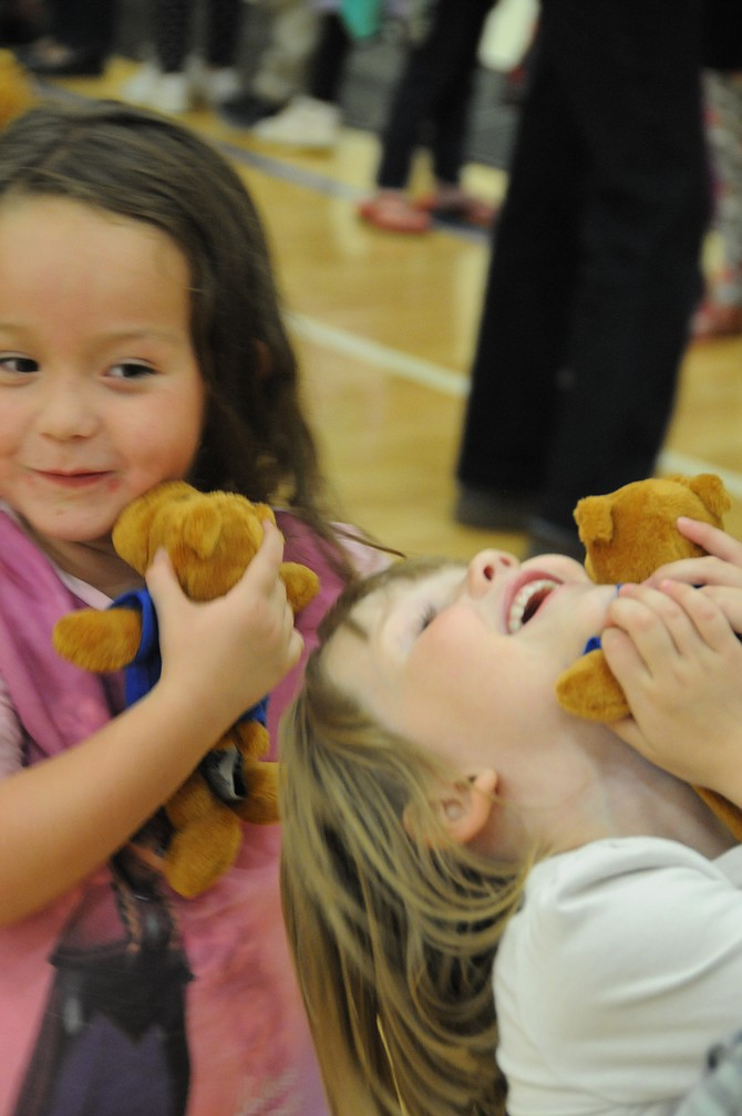 """Grangeville students give their new """"reading buddies,"""" donated by IdahoForestGroup, some love Wednesday, Sept. 23."""