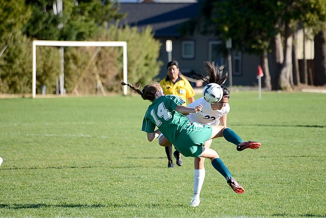 HRV had a physical match with Pendleton on Tuesday, but the Buckaroos were no match for the Eagles, losing 4-0. At right, midfielder/forward Sindy Magana collides with a Pendleton defender.