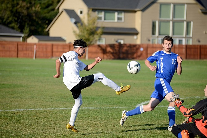 HORIZON SOCCER earned another league win on Wednesday, taking out Southwest Christian. Above, Salvador Ramirez chips a shot over the Wildcats' keeper that found its way to the back of the net.