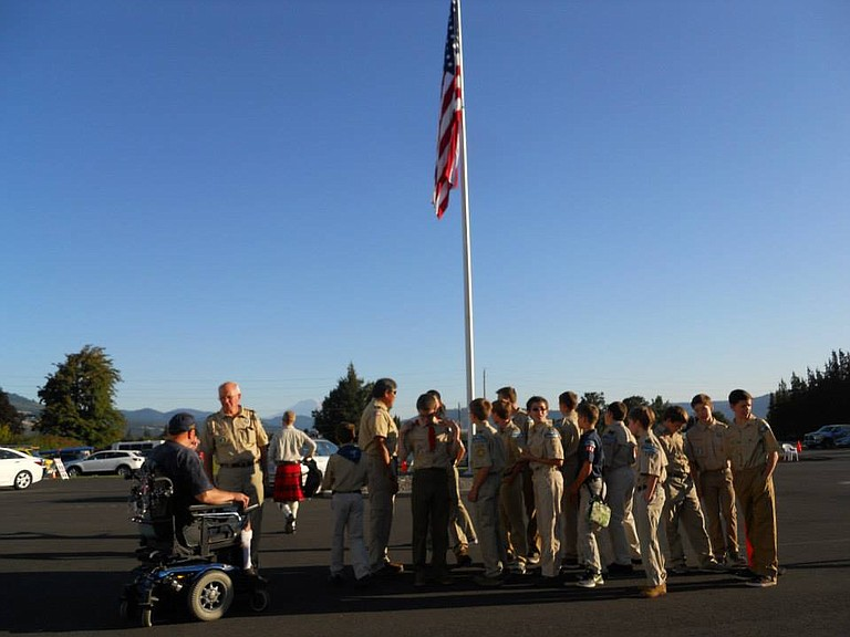 BOY SCOUTS, volunteers and WAAAM veterans participate in last year's flag retirement ceremony.