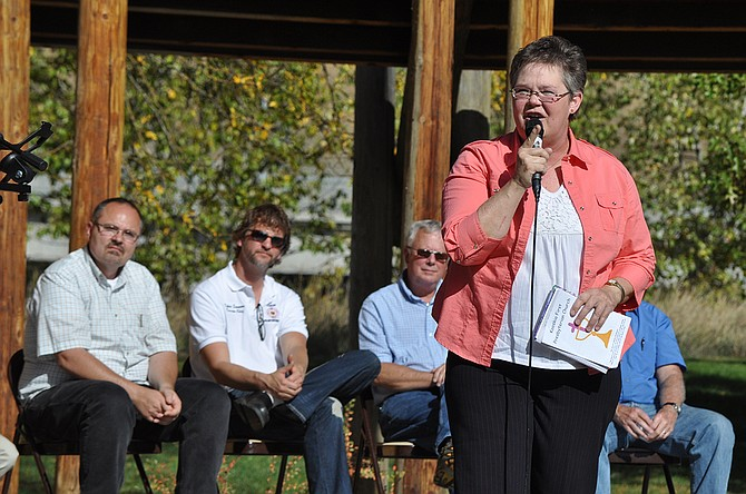 More than 100 people gathered on Sunday, Oct. 4, at Riverfront Park in Kamiah for an appreciation event for local firefighters, EMS and law enforcement for their actions and dedication during the 2015 fire season.   The speakers included (foreground) Reverend LuAnn Howard, Kooskia First Presbyterian Church. Seated in background are (L-R) Pastor Kelly Lineberry of The Life Center, Kamiah Chamber president and Kamiah firefighter Robert Simmons, and Lewis County Commissioner Greg Johnson.