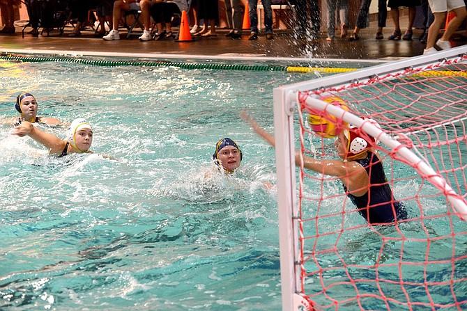 LAUREN ORR scores a goal during Tuesday's game against Sam Barlow High School.