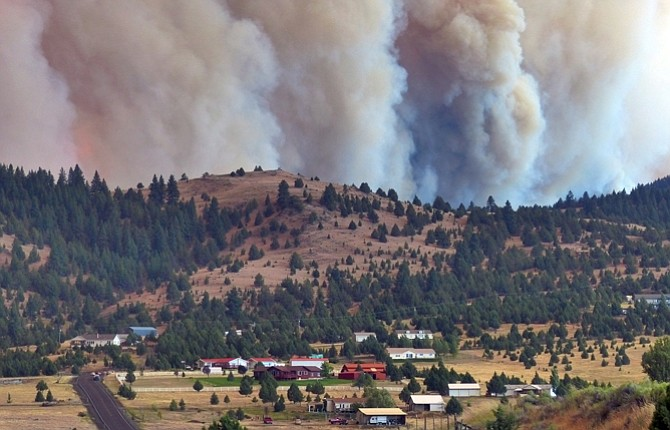 THE CANYON Creek Complex fire burns towards a rural subdivision of John Day on Friday, Aug. 14.