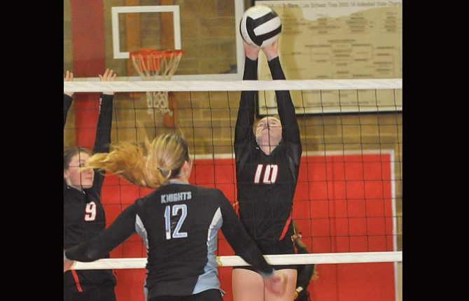 Dufur volleyball player Chloe Beeson (middle) makes a block of Condon-Wheeler's Piper Jamieson (12) in Big Sky Conference action at Dufur High School. Saturday, the No. 9-ranked Lady Rangers won their seventh and eighth straight matches in a double dual played this weekend in Hood River.